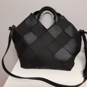 Black criss cross tone on tone bag